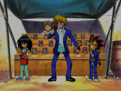 Mokuba, Jounouchi, and Yuugi in front of a card vendor in episode 43