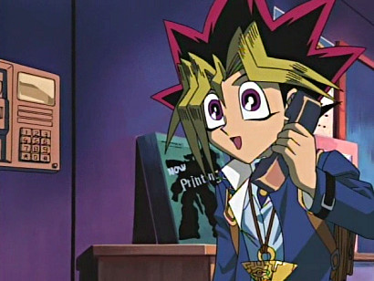 Yugi on the phone in episode 1