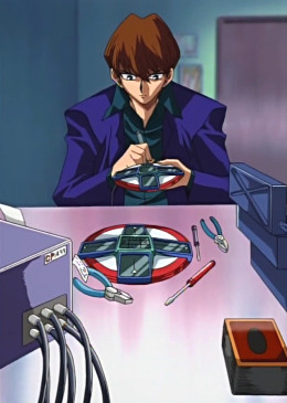 A pan-up of Kaiba working on his Duel Disk in episode 8