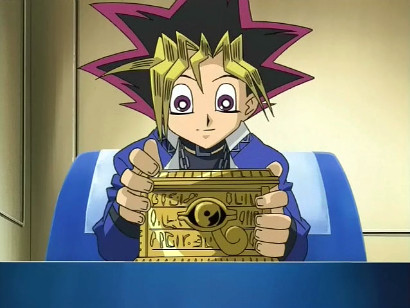 Yuugi storing his deck in the Millennium Puzzle's container in episode 220