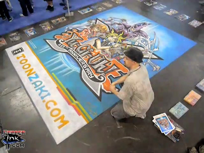 Eric Maruscak and his Yu-Gi-Oh! Chalk Mural at NYCC 2010