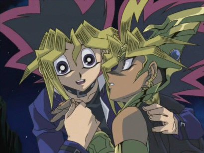 Yugi comforting the fallen pharaoh in episode 207