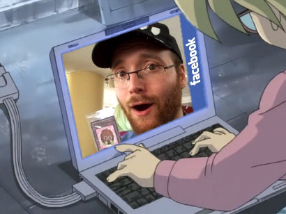 Rebecca with her laptop checking out Little Kuriboh on Facebook