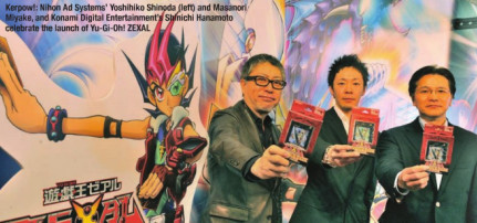 Representatives from NAS and Konami at MIPTV 2011 celebrating launch of Yu-Gi-Oh! ZEXAL