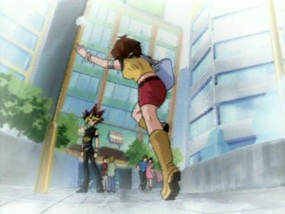 Tea Gardner waving and running toward Yugi at the end of episode 144
