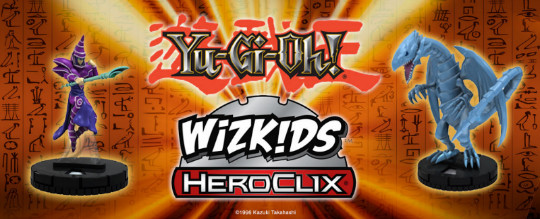 Dark Magician and Blue-Eyes White Dragon figures flanking the Yu-Gi-Oh! and Wizkids HeroClix logos