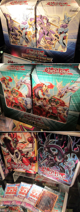 The Synchron Extreme and Master of Pendulum Structure Decks, and the Odd-Eyes Pendulum Dragon and Dark Rebellion Xyz Dragon Mega-Tins