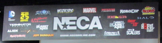 Banner hanging above the NECA booth at San Diego Comic Con 2015