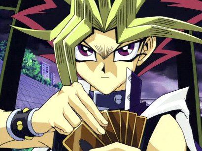 Yami Yugi scowling as he takes on Slifer the Sky Dragon in a duel against Marik in episode 66