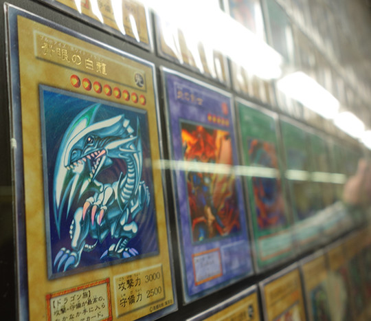 Blue-Eyes White Dragon card at the Yu-Gi-Oh! The Dark Side of Dimensions card exhibit in Shinjuku