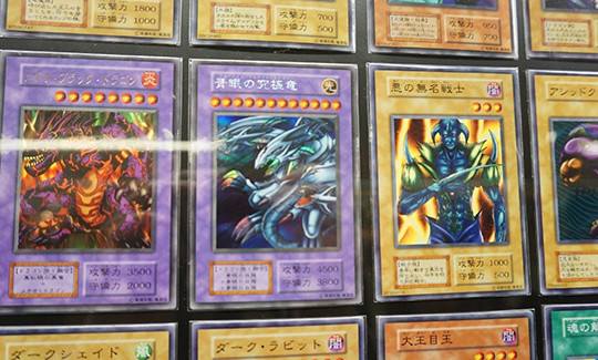 Blue-Eyes Ultimate Dragon card at the Yu-Gi-Oh! The Dark Side of Dimensions card exhibit in Shinjuku