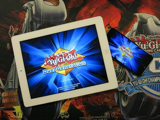 Photo of Yu-Gi-Oh! Duel Generation running on a tablet and phone