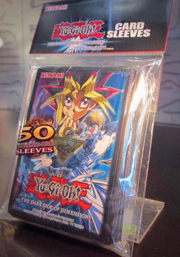 Yu-Gi-Oh! The Dark Side of Dimensions card sleeves on display at NYCC 2016