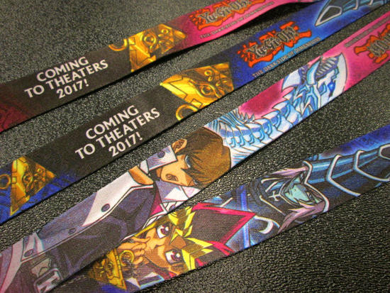 Close-up of the Yu-Gi-Oh! The Dark Side of Dimensions lanyards from NYCC 2016