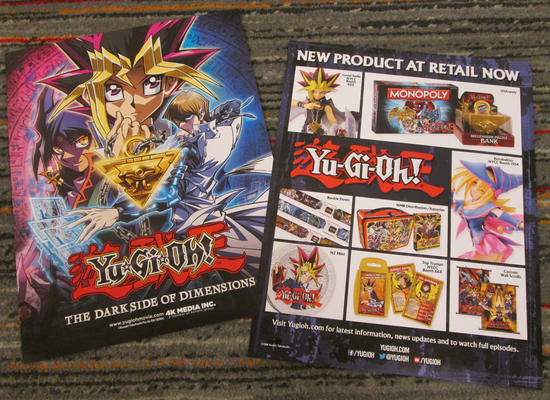 Front and back of the Yu-Gi-Oh! The Dark Side of Dimensions mini posters from NYCC 2016