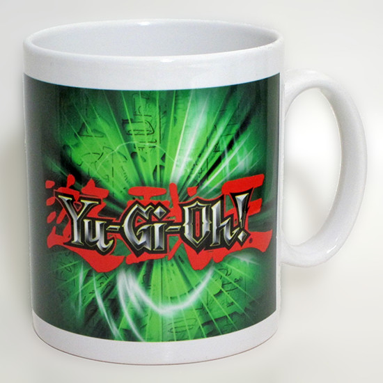 Large Yu-Gi-Oh! logo over a green background on a GB eye Yu-Gi-Oh! mug