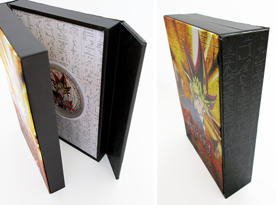 Closed and open views of the side of the New Zealand Mint Yami Yugi coin case