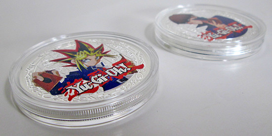 Side of the Yami Yugi and Seto Kaiba coins in their plastic protective case