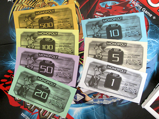 The different denominations of USAopoly Yu-Gi-Oh! Monopoly Duel Points money
