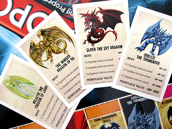 USAopoly Yu-Gi-Oh! Monopoly title deed cards for Holactie, Ra, Slifer, and Obelisk