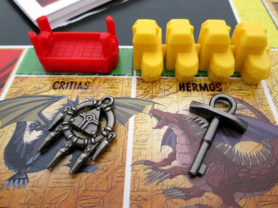 Close-up of the Millennium Ring and Key tokens on the USAopoly Yu-Gi-Oh! Monopoly board