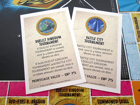USAopoly Yu-Gi-Oh! Monopoly title deed cards for the Duelist Kingdom and Battle City tournaments