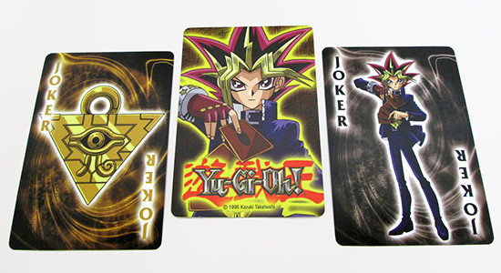 The design of the back of the Yu-Gi-Oh! playing cards and the two jokers
