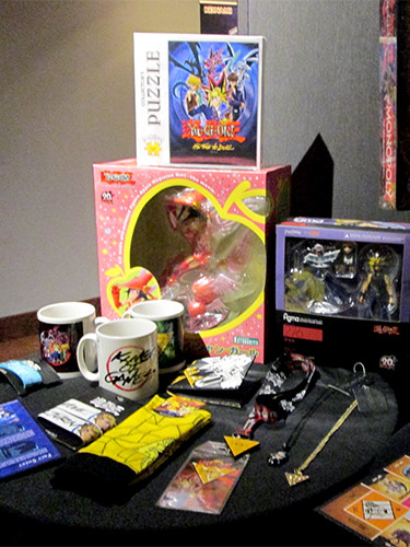 Yu-Gi-Oh! figures, mugs, and other goods on display at the after-party for the Yu-Gi-Oh! The Dark Side of Dimensions U.S. premiere