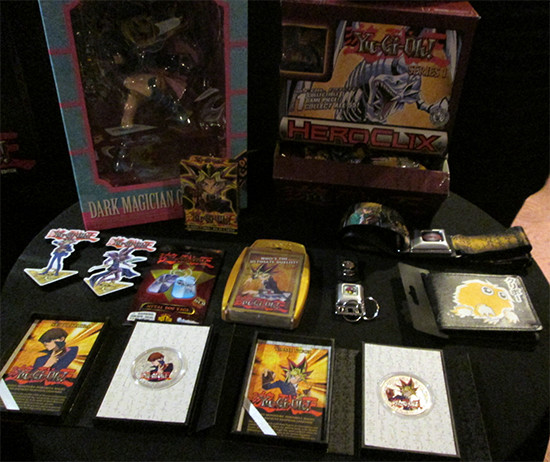Yu-Gi-Oh! silver coins, HeroClix, and other products on display at the after-party for the Yu-Gi-Oh! The Dark Side of Dimensions U.S. premiere