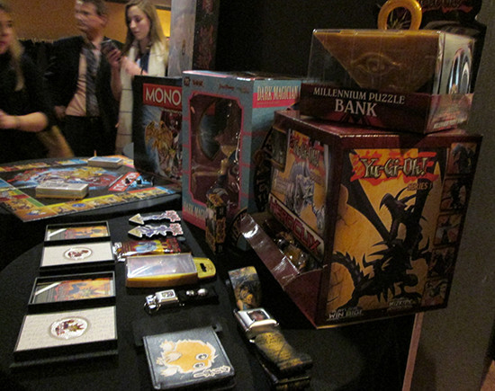 Yu-Gi-Oh! Millennium Puzzle bank, wallet, belt, and other merchandise on display at the after-party for the Yu-Gi-Oh! The Dark Side of Dimensions U.S. premiere