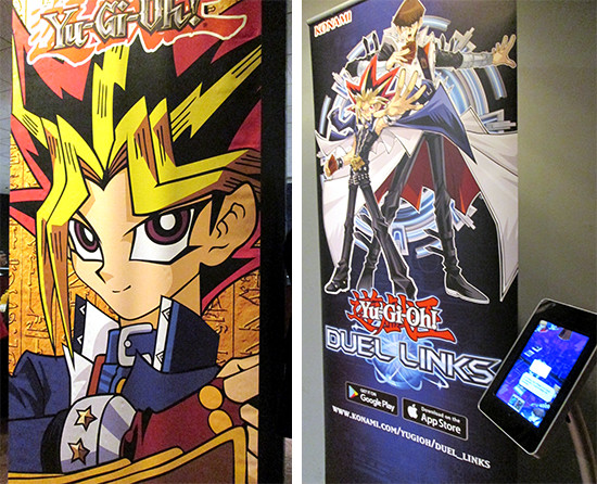 A Yami Yugi banner and Yu-Gi-Oh! Duel Links banner and tablet setup