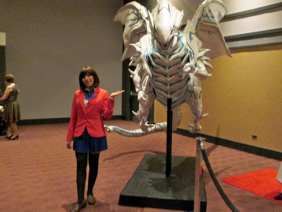 Tea Gardner cosplayer and Blue-Eyes Alternative White Dragon at the Yu-Gi-Oh! The Dark Side of Dimensions U.S. premiere screening