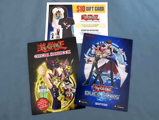 Postcard flyers for Yu-Gi-Oh! Duel Links, Scholastic's Yu-Gi-Oh! Official Handbook, and ShopYuGiOh.com