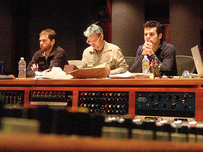 Yu-Gi-Oh! music composers Freddy Sheinfeld, Joel Douek, and Elik Alvarez in a studio