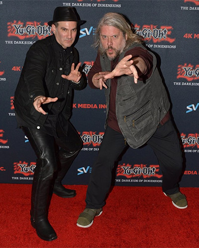 Voice actors Eric Stuart and Dan Green striking a funny pose at the U.S. Premiere of Yu-Gi-Oh! The Dark Side of Dimensions