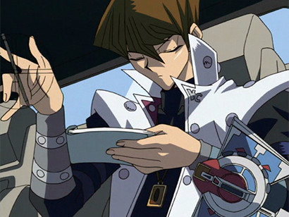 Kaiba twirling his pen as he prepares to sign a check in episode 171
