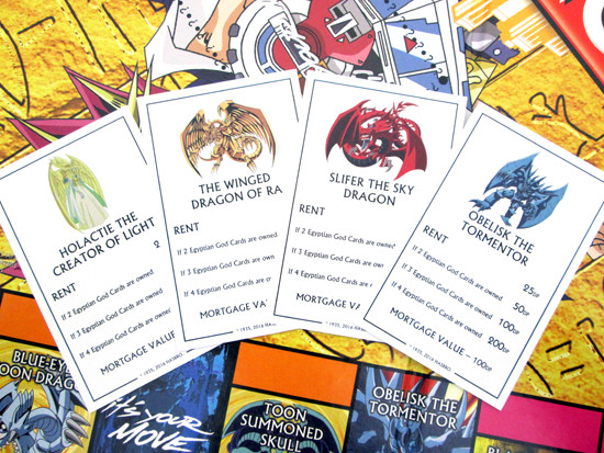 Winning Moves Yu-Gi-Oh! Monopoly title deed cards for Holactie, Ra, Slifer, and Obelisk