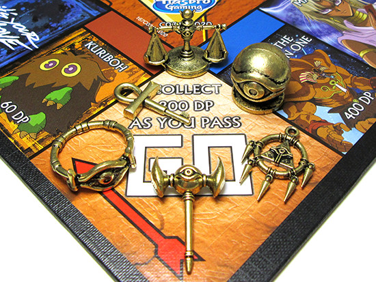 Winning Moves Yu-Gi-Oh! Monopoly Millennium Item tokens on the GO space