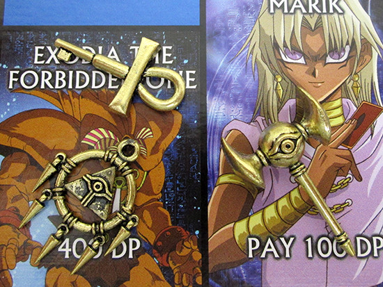 Close-up of the Millennium Key, Ring, and Rod on the Winning Moves Yu-Gi-Oh! Monopoly board