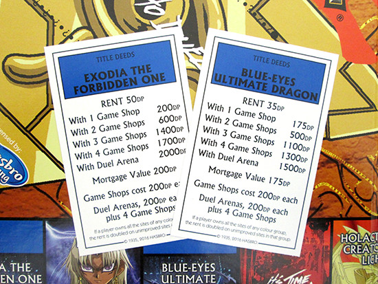 Front of the Winning Moves Yu-Gi-Oh! Monopoly Monster title deed cards