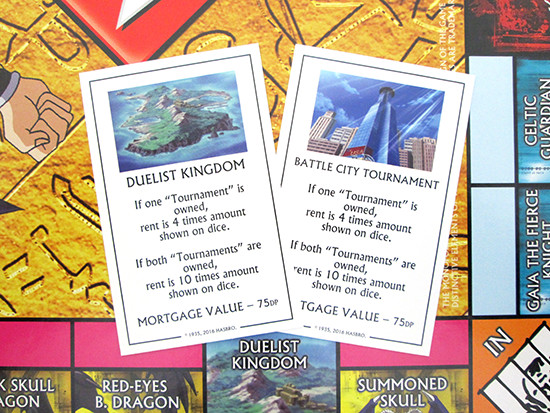 Winning Moves Yu-Gi-Oh! Monopoly title deed cards for the Duelist Kingdom and Battle City tournaments
