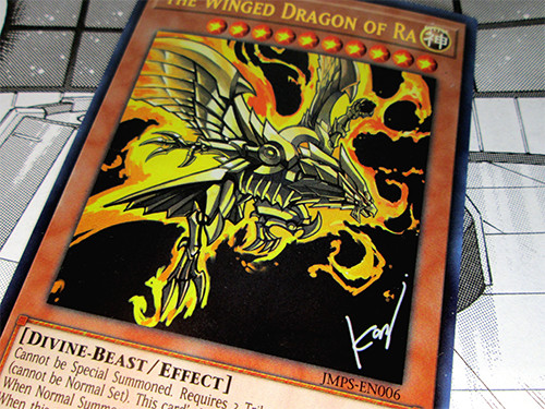 Close-up of the Yu-Gi-Oh! TCG The Winged Dragon of Ra card included with the Weekly Shonen Jump Fall 2018 Jump Pack