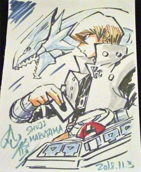 Seto Kaiba drawing a card with Blue-Eyes White Dragon, drawn live by Shuji Maruyama at Youmacon on November 3, 2018