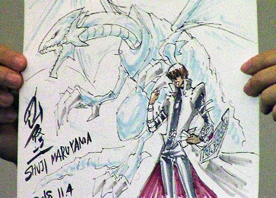 Seto Kaiba standing with Blue-Eyes White Dragon, drawn live by Shuji Maruyama at Youmacon on November 4, 2018