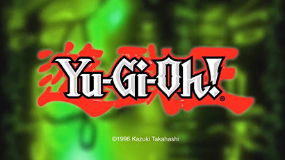 The Yu-Gi-Oh! logo on a green hieroglyphs background from the It's Time to Yule video