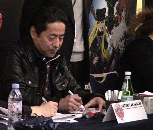 Kazuki Takahashi signing for fans at his autograph table at MAGIC 2019