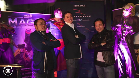 Kazuki Takahashi posing with some DC Comics statues at the MAGIC 2019 after-party