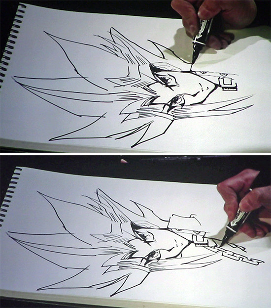 Kazuki Takahashi drawing more of Yugi's hair and his chain at his live drawing session at MAGIC 2019