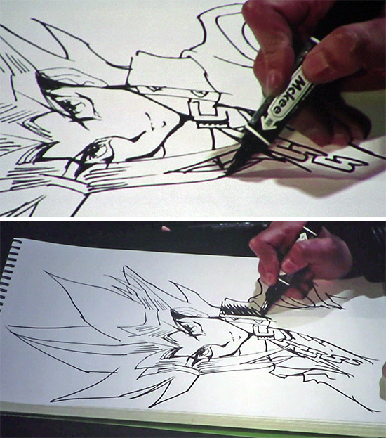 Kazuki Takahashi drawing and shading more of Yugi's clothes at his live drawing session at MAGIC 2019