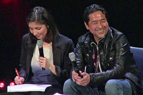 Kazuki Takahashi glancing to his left and laughing at his Q&A panel at MAGIC 2019